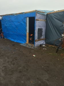 A cooking fire in a tent in the family area of the camp